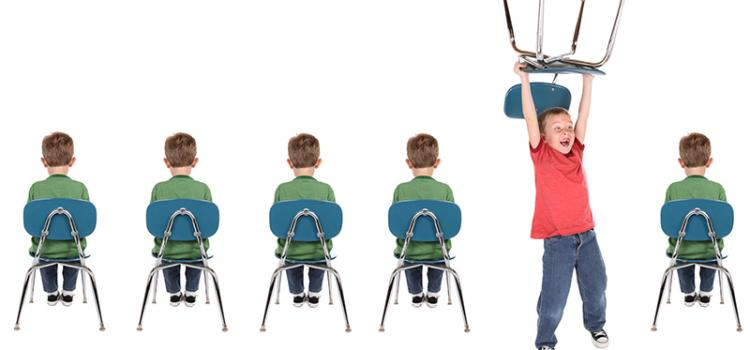 five children sit on chairs one child stands with chair held over head